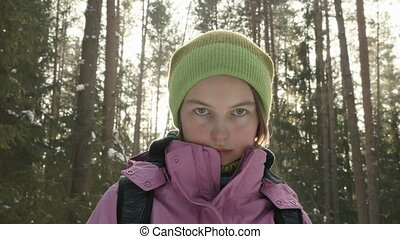 Young girl in the winter forest