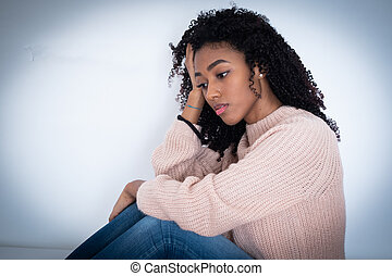 Young girl in trouble feeling sad and depressed
