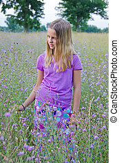 young girl in wildflowers