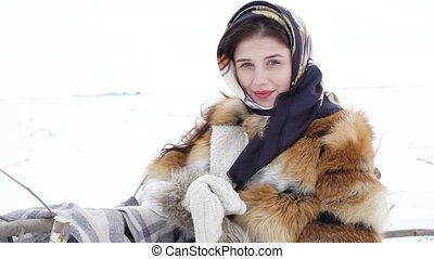 Young girl in winter clothes smiling and posing to camera