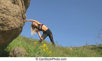 Young girl is engaged in sports on a beautiful day with a clear blue sky.
