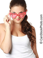 Young girl is holding red sunglasses