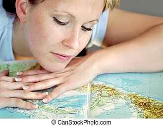 Young girl is reading a map