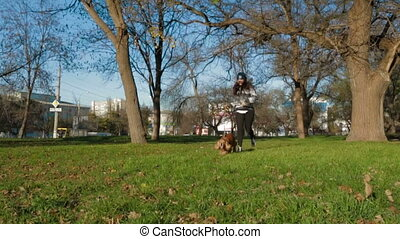 Young Girl Jogging In Park With Her Pet