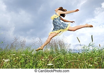 Young girl jumping in meadow