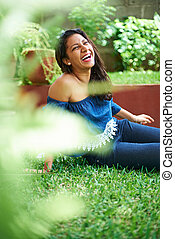 young girl laugh on grass