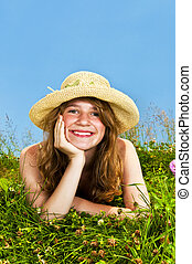 Young girl laying in meadow