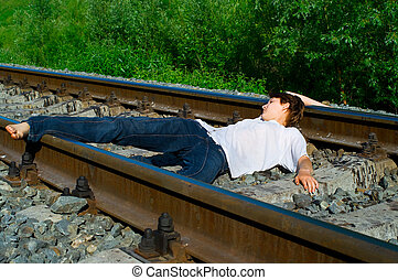 Young girl laying on a railway