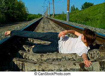 girl laying on a railway