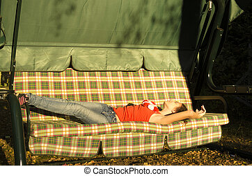 young girl laying on the daybed