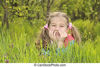 young girl lays in a field