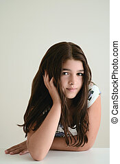 young girl leaning on table