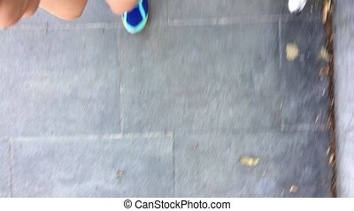 Young girl legs jogging with dog Jack russel pov