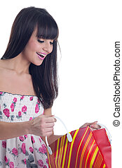 Young girl look in bag and smile