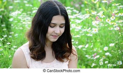 Young girl looking at camera outdoors