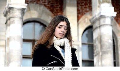 Young girl looking at the camera. Long dark hair, scarf,...