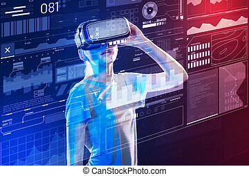 Young girl looking impressed while wearing virtual reality glasses