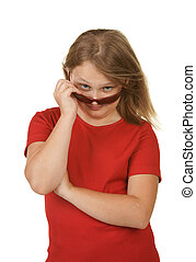 young girl looking over sunglasses