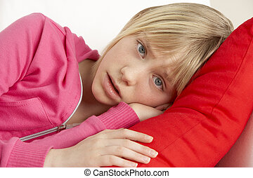 Young Girl Looking Sad On Sofa