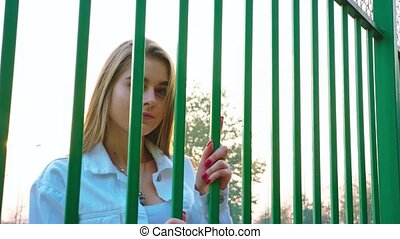 Young Girl Looking Through the Grid