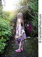 Young girl looking towards light. - Young Caucasian girl,...