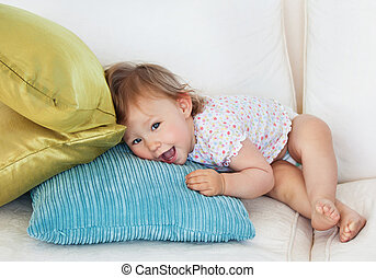 Young girl lying on sofa