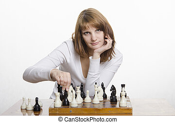Young girl makes a move, playing ch