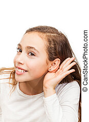 Young girl making a listening gesture isolated on white background