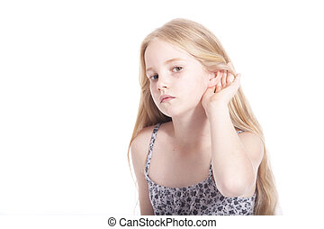 young girl making hearing gesture in studio