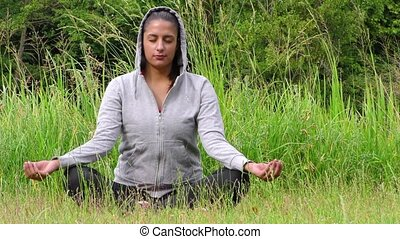 Young Girl Meditation in Nature on