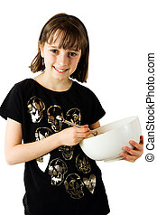 Young girl mixing a cake 2