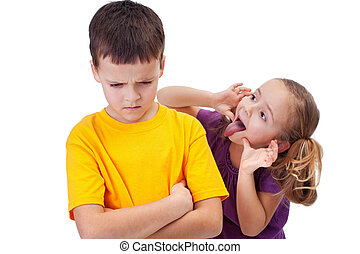 Young girl mocking boy - isolated - Young girl mocking angry...