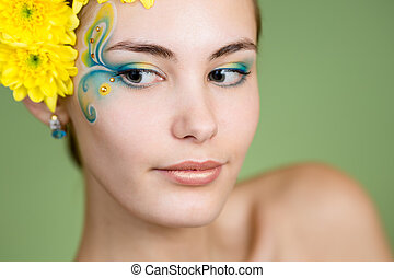 Young girl model with fantasy makeup and chrysanthemum...