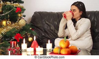 Young girl near Christmas tree
