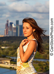 young girl on a background of blue sky