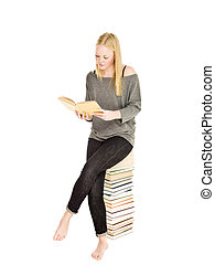 Young girl on a pile of books