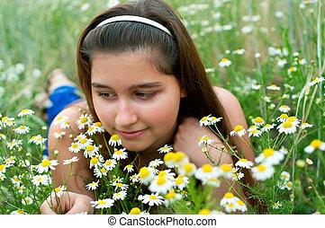 girl on chamomiles field