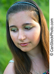 young girl on green background