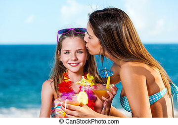 Young girl on holiday with mother.