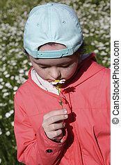 Young girl on the background of flowers field
