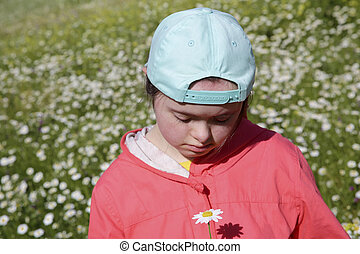 Young girl on the background of green field