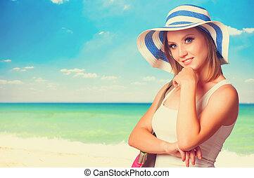 Young girl on the beach in spring time.