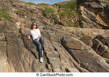 Young girl on the rocks