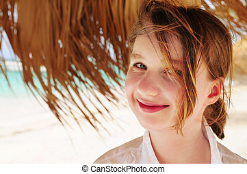 Young girl on tropical beach