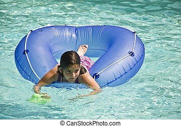 Young Girl on Tube in Pool