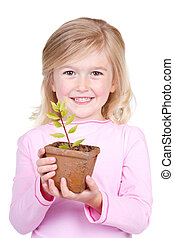 child holding a potted plant