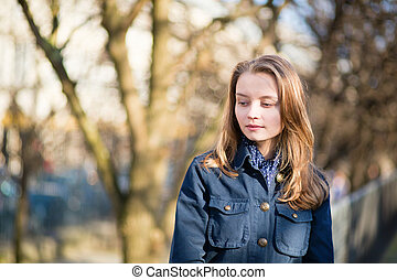 Young girl outdoors on a spring day