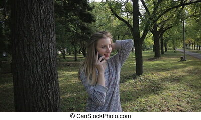 Young girl outdoors talking on the phone
