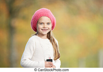 Young Girl Outdoors With MP3 Player
