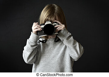 Young Girl Photographer Taking Photograph with Camera